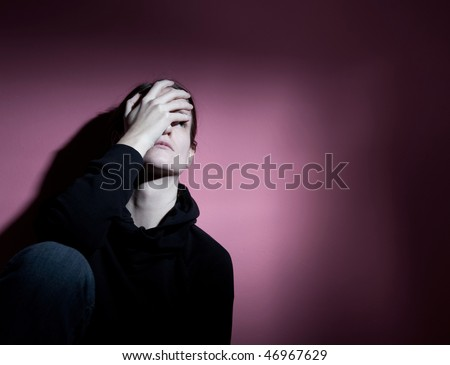 Young woman suffering from severe depression - stock photo