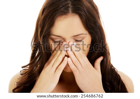 Young woman suffering from sinus pressure pain. - stock photo