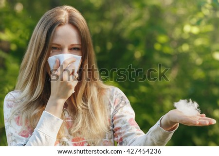 young woman suffering spring pollen allergy