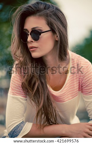young woman summer portrait with sunglasses outdoor day shot  - stock photo