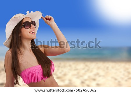 young woman sunbathing on the beach in summer, holiday