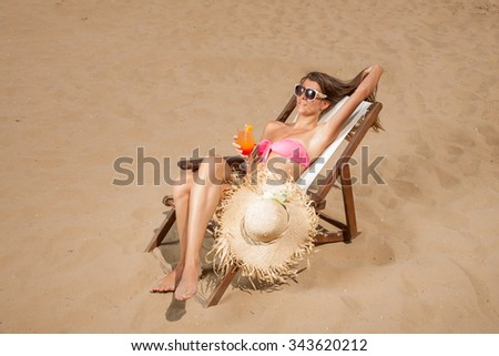 YOung woman suntanning on the beach - stock photo