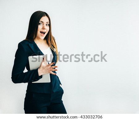 Young woman  surprise with  tablet isolated on white background. - stock photo