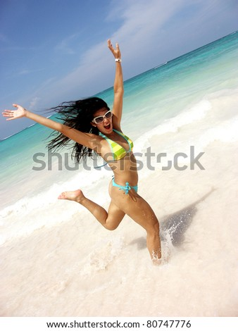 Young woman swimsuit running and enjoying at the beach - stock photo