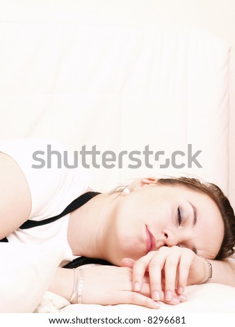Young woman takes a break and sleeps on the couch