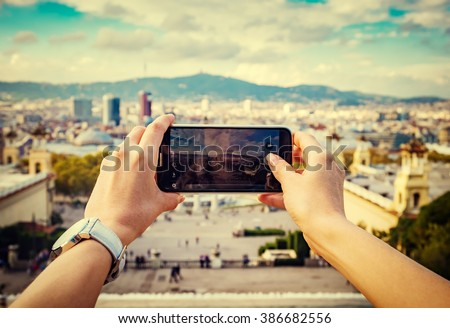 Young woman taking a picture of a city - stock photo