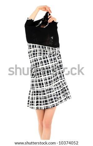 Young woman taking off black and white stylish dress. - stock photo