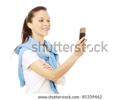 Young woman taking photos with  mobile phone camera, isolated on white background