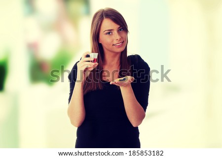 Young woman taking pills and syrup - stock photo