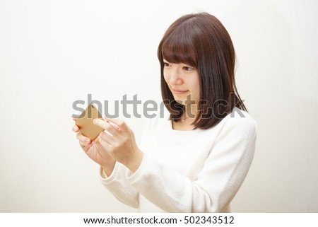 Young woman taking selfie photos with smile