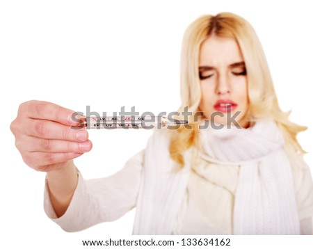 Young woman  taking thermometer. Sharpness on thermometer. - stock photo