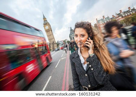 Young Woman Talking on Mobile in London - stock photo