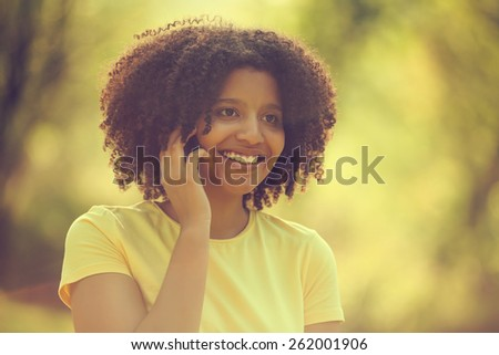 Young woman talking on phone, image is intentionally toned - stock photo