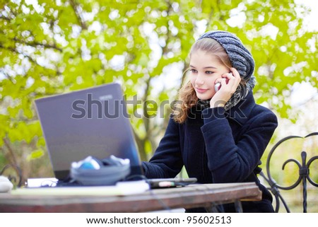 young woman talking on phone outdoor - stock photo