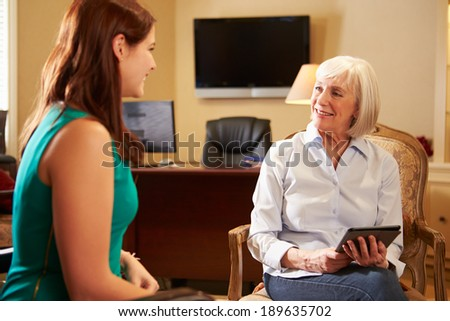 Young Woman Talking To Counsellor Using Digital Tablet - stock photo