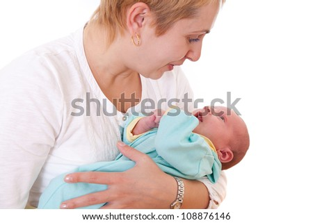 Young woman talking to her newborn baby