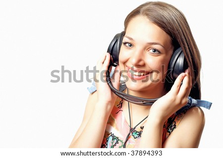 Young woman teenager listening music with headphones