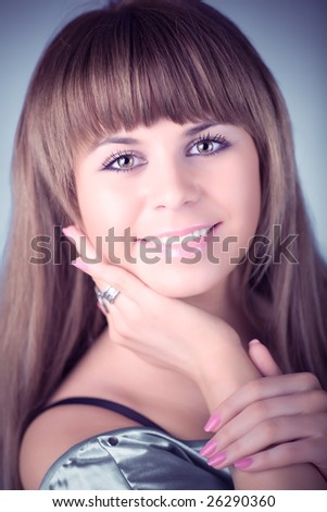 Young woman tender portrait. Soft blue tint. - stock photo