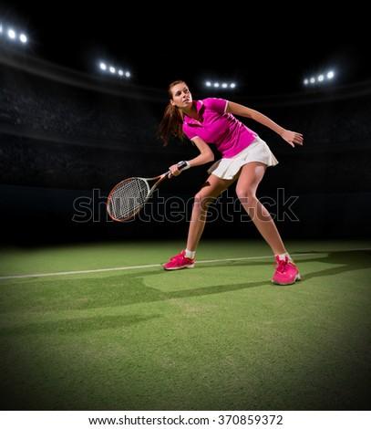 Young woman tennis player at stadium - stock photo