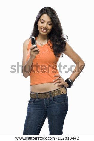 Young woman text messaging - stock photo
