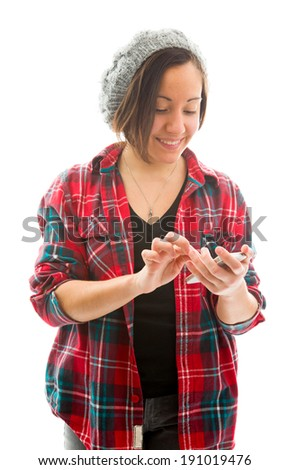 Young woman text messaging on mobile phone - stock photo