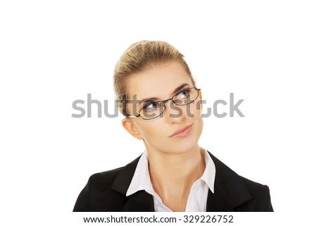 Young woman thinking about some concept. - stock photo