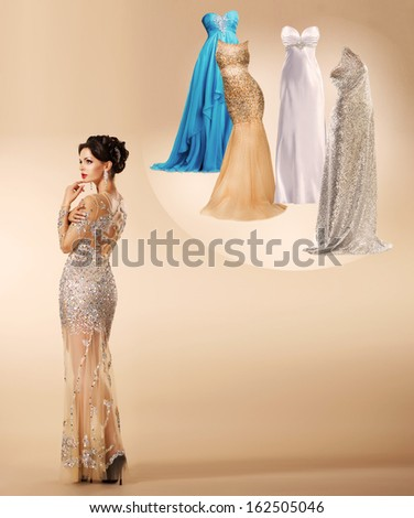 Young woman thinking which dress to wear on New Year's party . - stock photo
