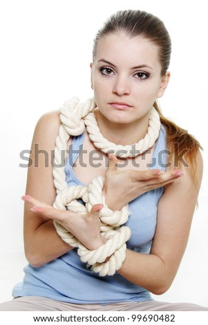 young woman tied up with rope over white - stock photo