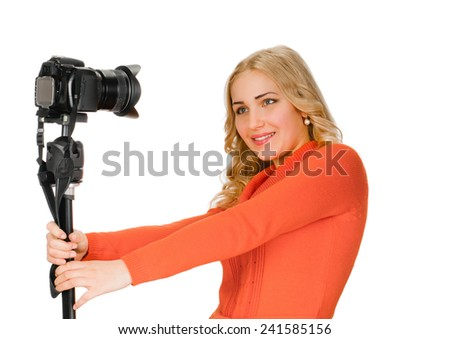 young woman to do her own self-portrait on white background - stock photo