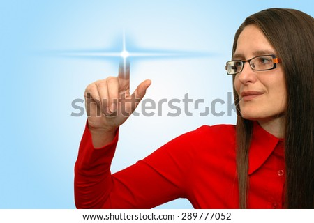 Young woman touches the virtual touch screen interface  - stock photo