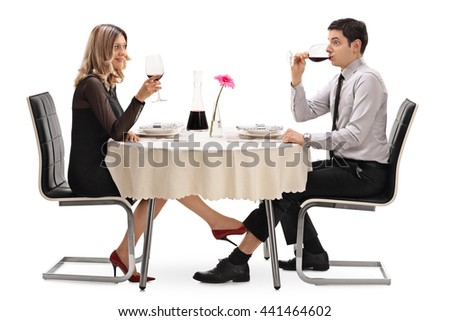 Young woman touching a man under the table with her foot isolated on white background
