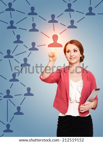 young woman touching a node in a network  - stock photo
