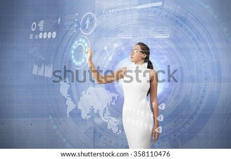 Young woman touching screen interface - stock photo