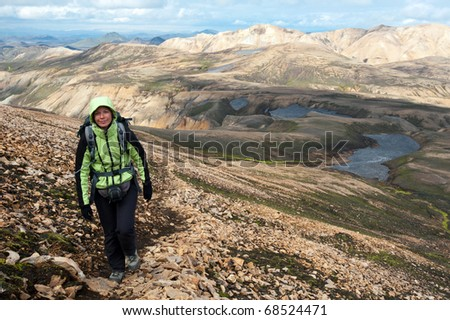 young woman tourist hiking in the Landmannalaugar mountains, Iceland - stock photo