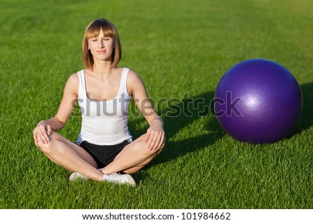 Young woman training in the park - stock photo