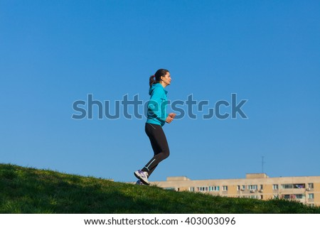 Young woman training in the park in a sunny day
