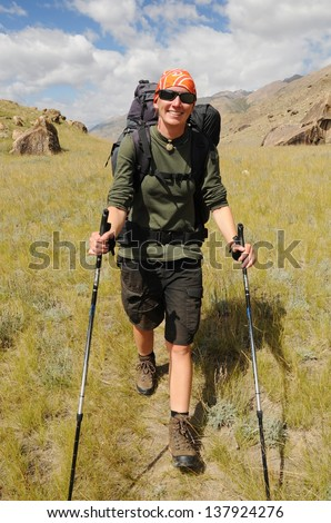Young woman trekking in mountain - stock photo