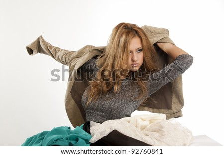Young woman trying out clothes to go out