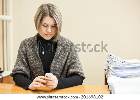 Young woman typing text on mobile phone, copyspace - stock photo