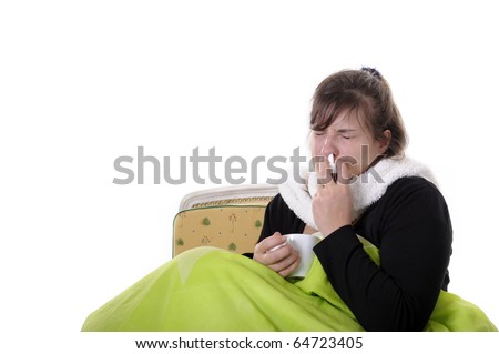 young woman under green blanket putting nosedrops in her nose. Isolated on white - stock photo