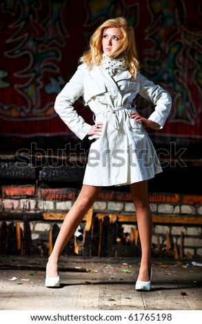 Young woman urban fashion. On ruined building background. - stock photo
