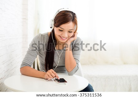 Young woman use of the music player - stock photo