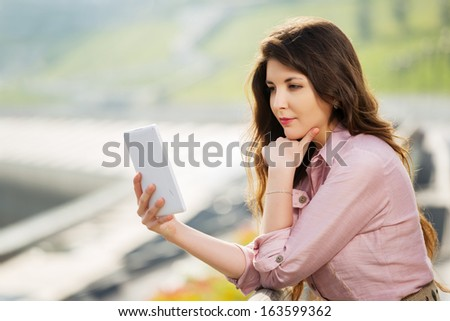 Young woman using a digital tablet computer - stock photo