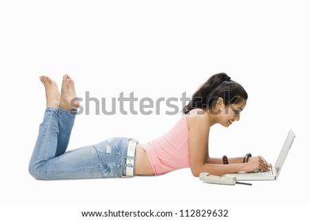 Young woman using a laptop - stock photo