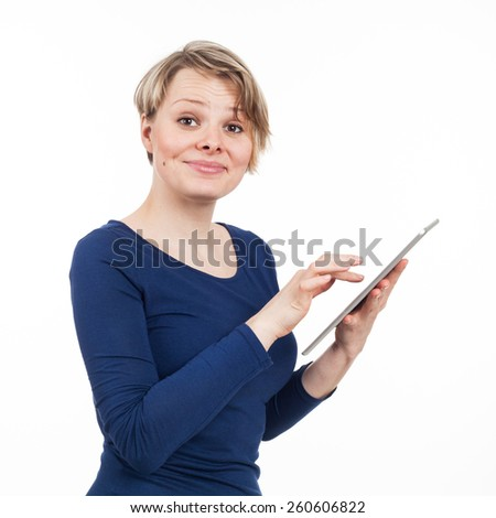 Young woman using an electronic tablet, isolated on white - stock photo