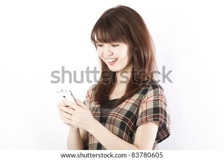 Young woman using by smart phone. Portrait of asian woman. - stock photo