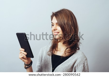 young woman using digital tablet computer - stock photo