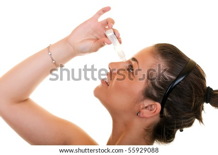 young woman using eye drops on white