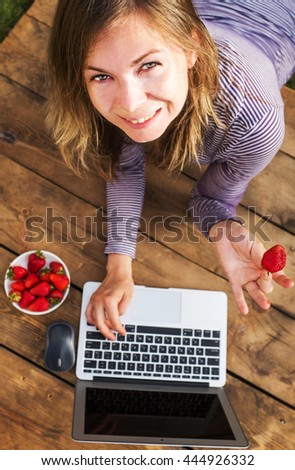 Young woman  using laptop computer - stock photo