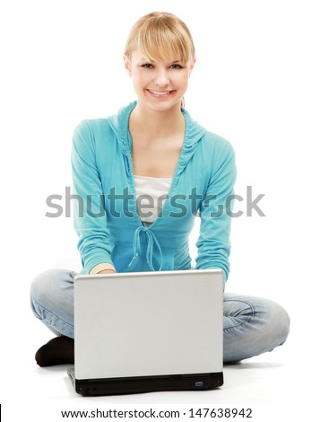 Young woman using laptop looking at copyspace. Isolated on white - stock photo